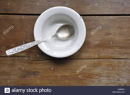 Wooden Kitchen Table Background Empty Soup Bowl With Vintage Silver Spoon On The Wooden Kitchen