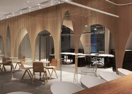 arched wooden partitions are used to separate the workspaces from