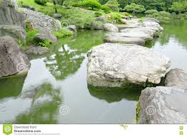 Zen Water Garden Stone Bridge Water Pond In Japanese Zen Garden Stock Photo