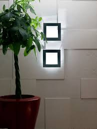 decoration artistic lighting on the white wall in square pattern
