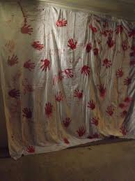 diy bloody handprint a white sheet red paint and your hands
