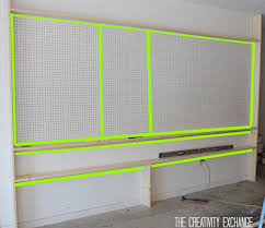 Pegboard Cabinet Doors by Tutorial For Organizing The Garage With A Pegboard Storage Wall