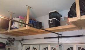 ceiling mounted wooden shelf the garage journal board