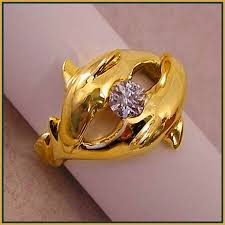 dolphin engagement ring dolphins courting ring is cast in 18 karat yellow gold