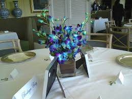 Cube Vase Centerpieces by Blue Orchids In A Cube Glass Vase As Centerpiece Yelp
