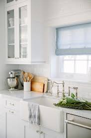 White Kitchen With Square Window And Blue Linen Roman Shade