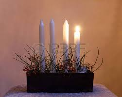 typical swedish advent candle stick holder with decorations and