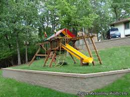 swingset on sloped retaining wall yard garden yard pinterest