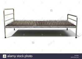 a metaphor showing a literal bed of nails with a metal frame on an