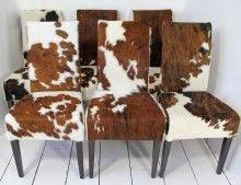 Cowhide Dining Room Chairs A Traditional Wing Back Chair Is Updated In Natural Cowhide