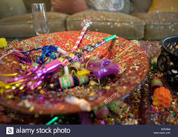 new years party poppers new years party wreckage including a chagne glass confetti