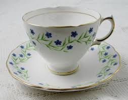 vintage tea cup and saucer with blue flowers made by royal vale