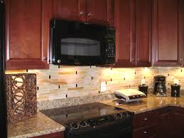 mosaic tile for kitchen backsplash finished our backsplash brown granite cherry cabinets