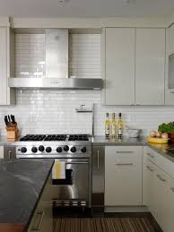 modern white kitchen backsplash 2 x12 white subway tile and a contrasting warm gray grout from