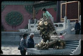 lion dog statue girl climbs on lion dog statue stock photo getty images