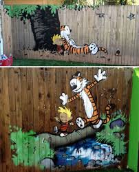 15 garden fences that are also works of art 7 calvin and hobbes mural fence decor