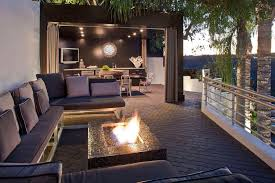 modern deck with exterior tile floors by kari whitman zillow
