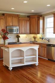 kitchen white wooden kitchen island with wooden countertop and