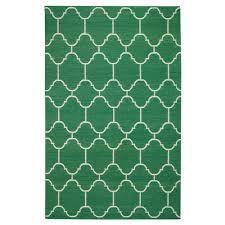 serpentine rug in emerald green and nursery necessities in