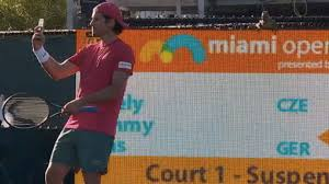 tommy haas takes a selfie with iguana on court at the miami open