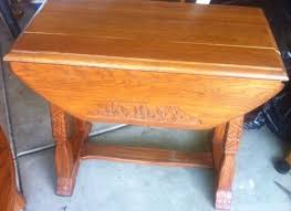 Drop Leaf End Table A Brandt Ranch Oak Drop Leaf End Table With Carvings T M Cowboy