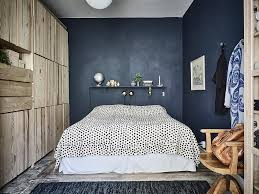 bedroom with dark walls and natural wood last home decor