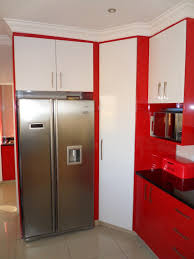 high gloss white and red two tone kitchen with a bullnose door