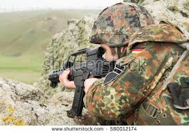 white soldier camoflage clothing bulletproof stock photo