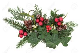 christmas floral arrangement with red baubles holly ivy