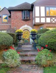a colorful tudor revival garden old house restoration products