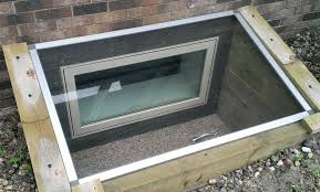 basement window well what are the different types of basement window well covers