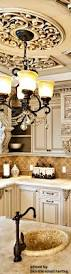 stunning medallion ceiling feature and chandelier in kitchen