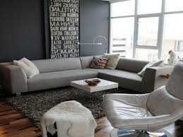 Designer Sofa Throws Grey Living Room Walls Brown Furniture Round Brown Wooden Coffee
