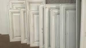 is alder wood for cabinets copy of knotty alder cabinets refinished with antique white glaze kwik kabinets