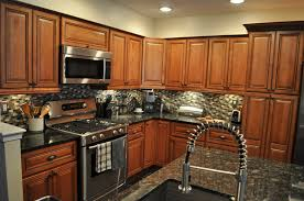 Kitchen With Brown Cabinets Kitchen Large Kitchen With Hanging Small Chandeliers Over Island