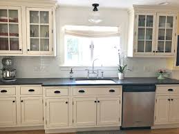 black kitchen cabinets with white subway tile backsplash cabinets white subway tile backsplash black
