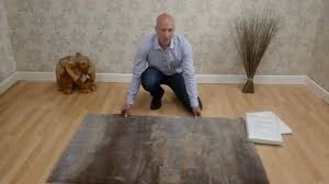 Rug On Laminate Floor How To Stop Your Rug From Slipping And Sliding Youtube