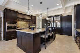 incredible dark kitchen design with three glass pendant lamp and