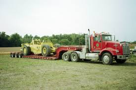 kenworth t800 lowboy hauling a euclid s 7 scraper this might
