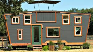 unique well crafted tiny home with sunken roof deck and slanted