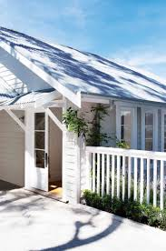 weatherboard house colours katrina chambers this gorgeous light and bright beach house painted dulux grey pebble with colorbond roof windspray