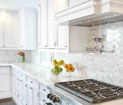 white kitchen cabinets with marble counters the lowdown on marble countertops in kitchens and bathrooms