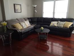 Dark Cherry Laminate Flooring Black Sectional Couch With Yellow Throw Pillows And Cherry