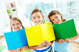 portrait of happy classmates with open books smiling at in