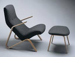 eero saarinen womb chair and footstool high backed lounge chair