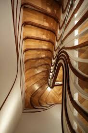 top view of stylish curved staircase with organic form home