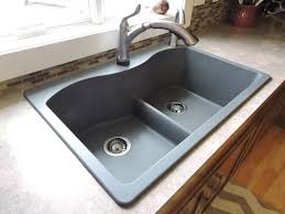 inspiring black kitchen sink with granite countertop and glass