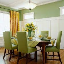 dining room wainscoting tall white color and green parson chairs