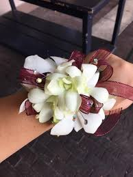 corsage flowers white maroon orchid wrist corsage in pleasanton ca