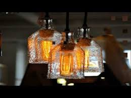 Diy Bottle Chandelier Recycled Bottles Made Into A Beautiful Chandelier Easy Diy